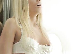Dream Girl In White Lingerie Fucks A Slim Dildo